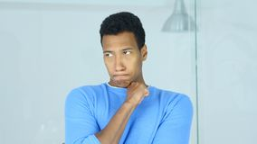 Brainstorming, Thinking Young Pensive Afro-American Man stock photography