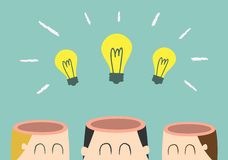 Brainstorming. Three opened heads with three light bulbs Stock Image