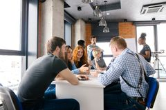 Brainstormng process of office workers sitting around the table royalty free stock image