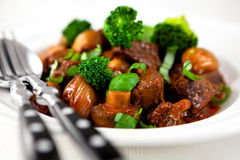 Braised beef with broccoli and mushrooms royalty free stock photos
