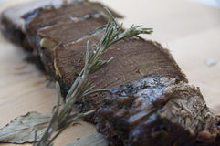 Braised beef. With herbs and garlic Stock Photography