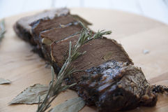 Braised beef. With herbs and garlic Royalty Free Stock Photography