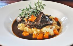 Braised Beef with Parsnip Mash and Roast Pumpkin Stock Photo