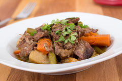 Braised beef pot roast stew. With vegetables on table Stock Image
