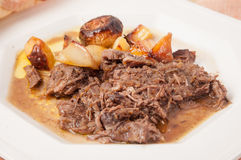 Braised beef with potatoes and onions. Royalty Free Stock Images
