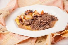 Braised beef with potatoes and onions. Stock Images