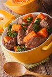 Braised beef with pumpkin closeup in the pan. vertical Stock Photography