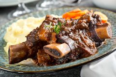 Braised Beef Short Ribs. Delicious braised beef ribs with mashed potato and carrots stock photography