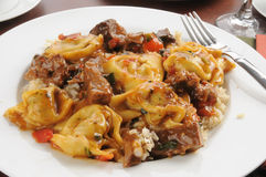 Braised beef tips with tortellini Royalty Free Stock Photography