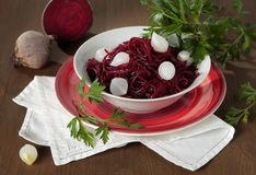 Braised beets with small pickled onions Royalty Free Stock Image