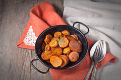 Braised carrot with thyme, vegetarian dish Stock Images