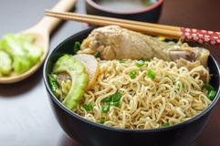 Braised chicken Drumstick with bitter gourd noodle Stock Photos