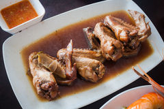Braised chicken wings black soup. Stock Image