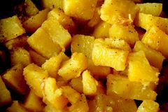 Braised colorfull potatoes close-up. Braised colorfull testy delicious potatoes with some spices close-up Royalty Free Stock Photography