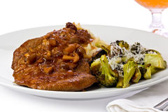 Braised Cube Steak. Steak with mashed potatoes and broccoli topped with traditional south african Monkey gland steak sauce, which is made from tomato sauce royalty free stock photo