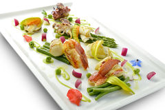 Braised Fish Dish Shrimp Lobster Scallop Squid Octopus Asparagus. Pea Beans in square plate Royalty Free Stock Photos