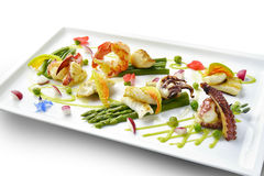 Braised Fish Dish Shrimp Lobster Scallop Squid Octopus Asparagus. Pea Beans in square plate Stock Photo