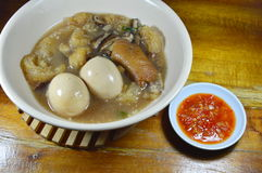 Braised fish maw in red gravy topping boiled egg and spicy chili sauce Royalty Free Stock Photography
