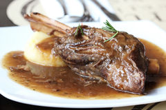 Braised lamb shank in mint and rosemary gravy royalty free stock image
