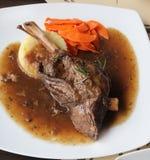 Braised lamb shank in mint and rosemary gravy Stock Photo
