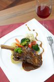 Braised lamb shank serve with red wine Stock Photography