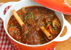 Braised Lamb Shanks in Casserole Dish Royalty Free Stock Photo
