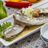 Braised mackerel fish with chili on white platter Royalty Free Stock Images