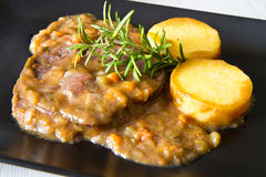 A braised meat with polenta Stock Photo