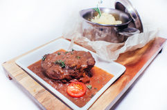 Braised meat in sauce Royalty Free Stock Image