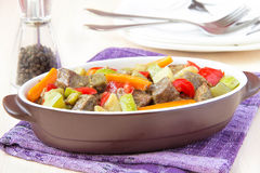 Braised meat stew with beef and vegetables in pot Royalty Free Stock Images