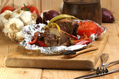 Braised meat in tinfoil Stock Images