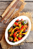 Braised peppers with aubergine, garlic and green onions. Hearty diet food. Top view Royalty Free Stock Photos