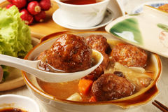 Braised pork balls in soy sauce. Chinese pork meatballs stewed with cabbage royalty free stock image