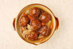 Braised pork balls in soy sauce. Chinese pork meatballs stewed with cabbage royalty free stock photos