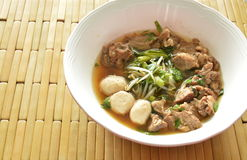 Braised pork and bean sprout in brown soup on bowl Royalty Free Stock Photography