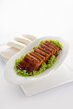 Braised pork belly. A very popular dish in Chinese cuisine, served with Chinese steamed bun Stock Photos