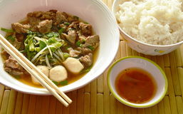 Braised pork in brown soup and spicy chili sauce eat couple with rice Stock Photos