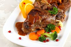 Braised rabbit meat with vegetables and potato dumplings Stock Image