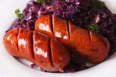 Braised red cabbage and grilled sausages closeup. horizontal Royalty Free Stock Photos