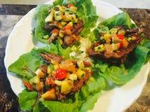 Braised short rib with peanut sauce and mango salsa Stock Images