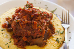 Braised veal on bed of polenta Stock Photography