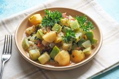Braised zucchini with vegetables and sesame seeds. Rustic delicious cuisine. royalty free stock photos