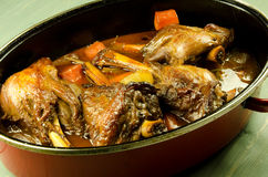 Braising lamb shanks Stock Images
