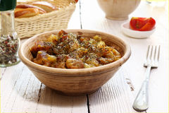 Braising meat with Italian herbs Stock Image