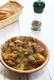 Braising meat with Italian herbs Stock Photography