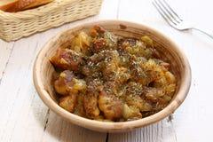 Braising meat with Italian herbs Stock Photos
