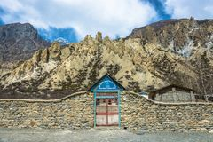 The metal gate in the stone fence – the entrance to the primary school in the village of Braka, April 3, 2018, Nepal. Braka, Nepal – April 3, 2018 royalty free stock photo