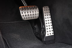 Brake and accelerator pedal. Brake pedal and the accelerator pedal in a car with automatic transmission Stock Photos