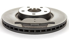 Brake disc and brake pad. New brake disc and a new brake pad Stock Photography