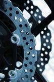 Brake disc detail. Closeup detail of a racing motorcycle's brake disc Royalty Free Stock Photo